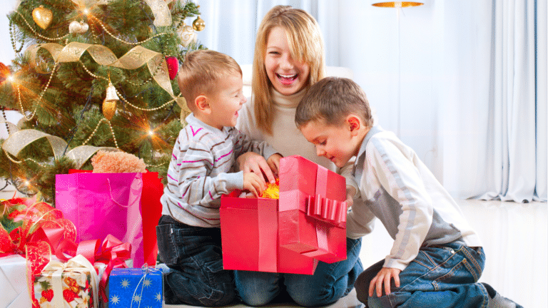 mother and sons opening a gift