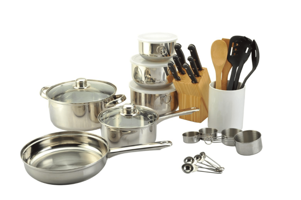 kitchen set with pot, measuring spoon, cup and knives