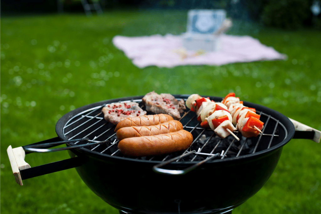 barbecue grill with sausage, pork and vegetables