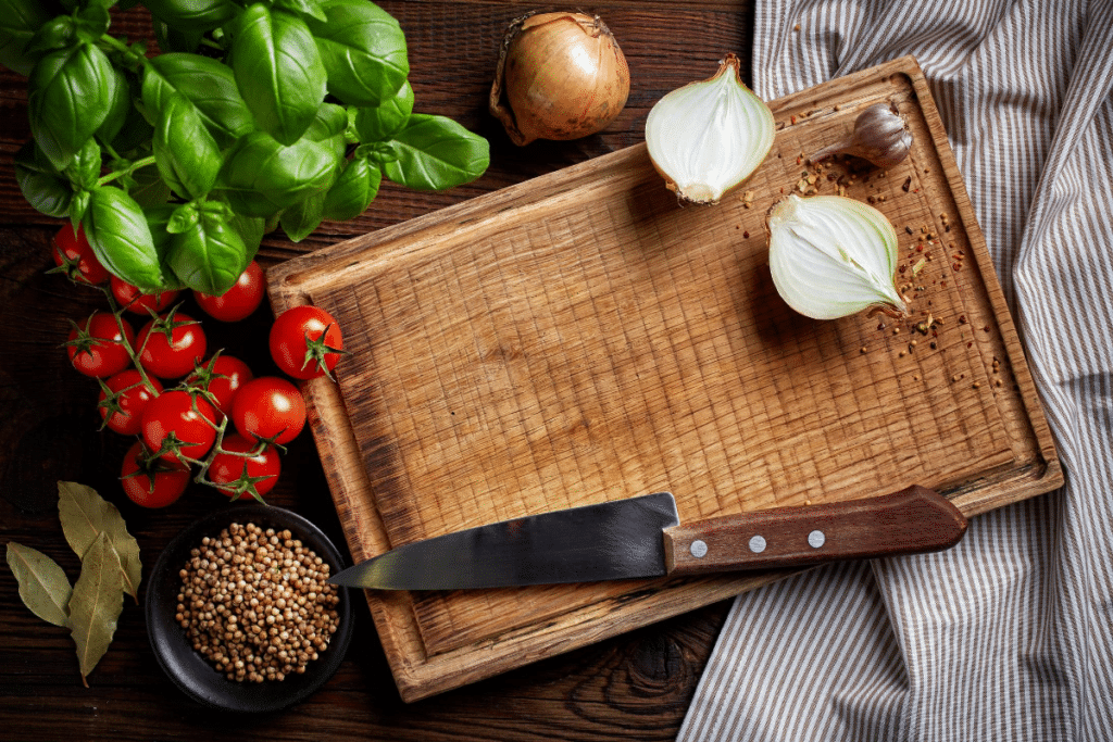 wooden chopping board with knife and spices