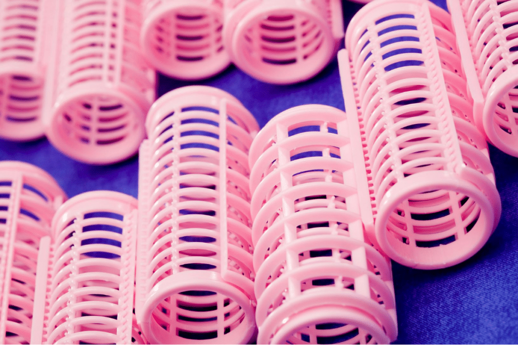 pink-colored plastic hair curler