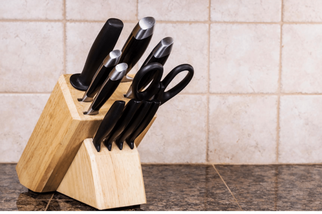 set of knife and scissors in a wooden container
