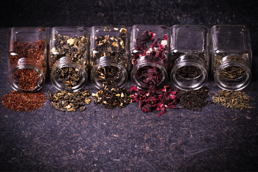 variety of jar with different tea powder