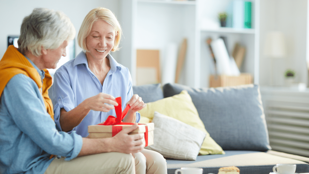old couple happily opening a gift together