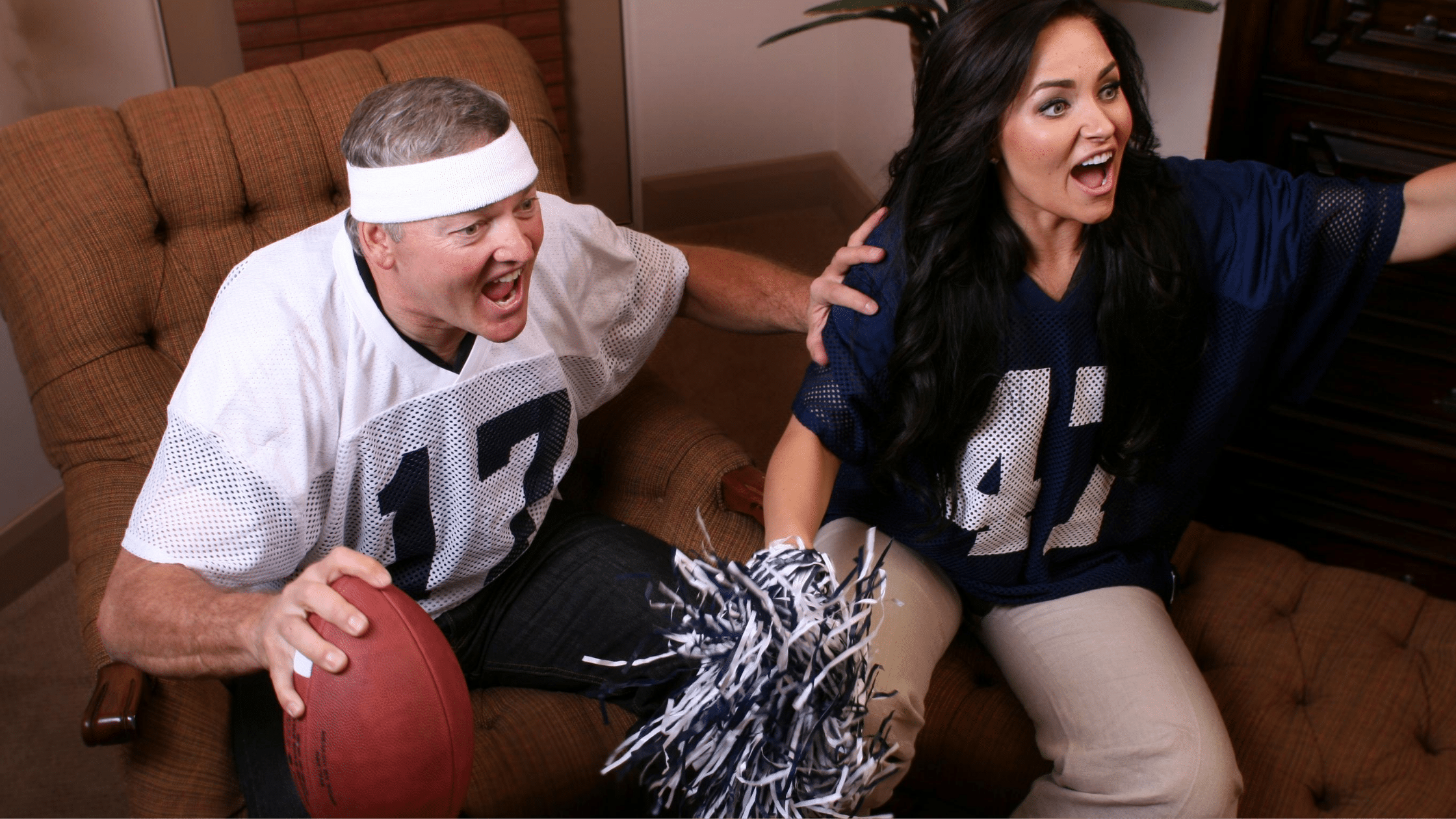 man and woman excited for a game