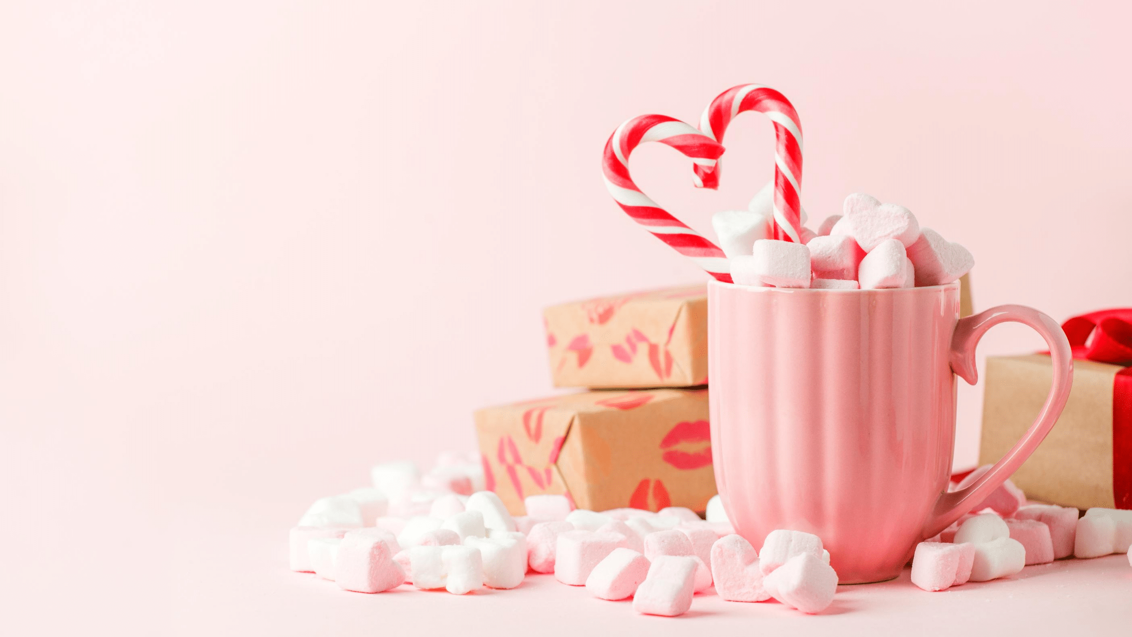 pink mug with candies and marshmallows